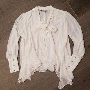 Tops - Flowy shark bite blouse with bow detail